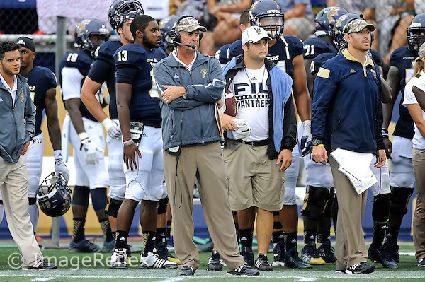 20 September 2014:  FIU Football Head Coach Ron Turner watches his players in the first half as the University of Louisville Cardinals defeated the FIU Golden Panthers, 34-3, at FIU Stadium in Miami, Florida.