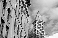 Facade of a Victorian building with the Smith Tower in back, Pioneer Square district, Seattle, Washington, USA
