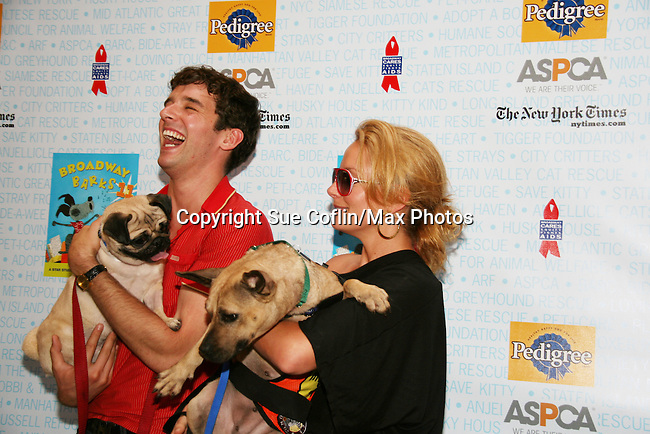 """Ugly Betty's Michael Urie & Becky Newton at Broadway Barks 11 - a """"Pawpular"""" star-studded dog and cat adopt-a-thon on July 11, 2009 in Shubert Alley, New York City, NY. (Photo by Sue Coflin/Max Photos)"""