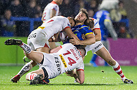 Picture by Allan McKenzie/SWpix.com - 09/03/2018 - Rugby League - Betfred Super League - Warrington Wolves v St Helens - Halliwell Jones Stadium, Warrington, England - Joe Philbin is tackled by Dominique Peyroux, Luke Douglas and James Roby.