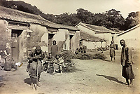 BNPS.co.uk (01202 558833)<br /> Pic: DominicWinterAuction/BNPS<br /> <br /> Chinese village.<br /> <br /> Revealed - A fascinating photo album from the very early days of British Hong Kong...long before the skyscrapers covered it over.<br /> <br /> The 150 year old photos of Hong Kong taken by one of the first British photographers to venture to the Far East have emerged for sale for £15,000.<br /> <br /> John Thomson, who was also a geographer, left Edinburgh for Singapore in 1862 and spent the following decade travelling the region.<br /> <br /> He explored a decidely low-rise Hong Kong from 1868 to 1870, taking numerous pictures of the rapidly expanding settlement and its industrious inhabitants.<br /> <br /> They capture the area, which is currently engulfed in unrest and protest, at a far more tranquil time.<br /> <br /> The photos are being sold with auction house Dominic Winter, of Cirencester, Gloucs.