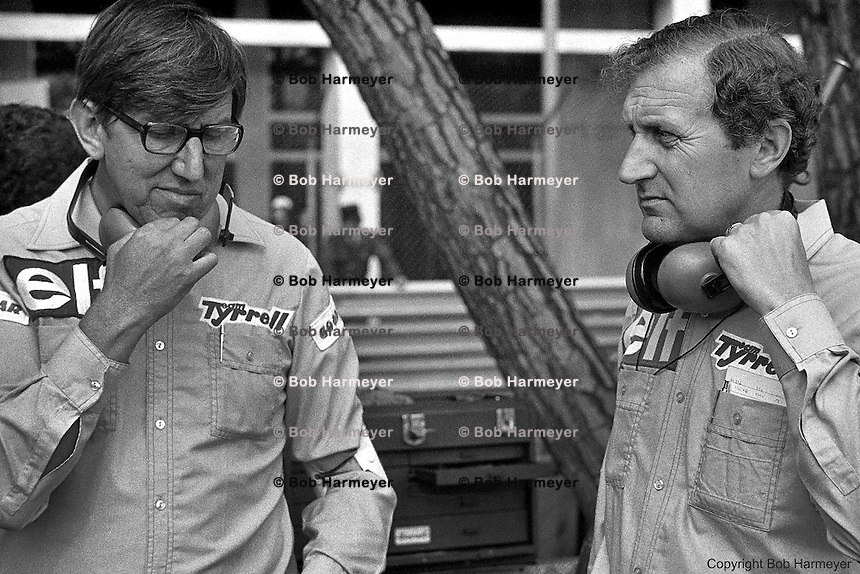 Ken Tyrrell (left) with Derek Gardner, designer of the Tyrrell P34 six-wheel Formula 1 car, in the pit lane during practice for the 1976 Grand Prix of Monaco.
