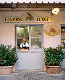 ITALY, Orvieto, Umbria,  portrait of chef Lucio Sforza in front of his restaurant L'asino D'oro.
