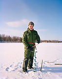FINLAND, Rovaniemi, portrait of a mature man ice fishing