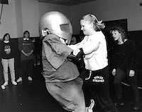 Women learning self defense at Impact Model Mugging Class