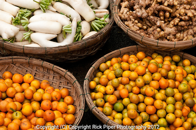 Kumquats, root ginger and horseradish for sale at the fruit and vegetable market, Bach Dang St, Hoi An, Viet Nam