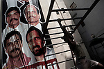 Havana (Cuba). September 2006..Poster of the Cuban five. The Cuban Five are Gerardo Hernández, Antonio Guerrero, Ramón Labañino, Fernando Gonzáles, and René Gonzáles. After being arrested in Miami, Florida in September 1998, they were indicted by the U.S. government on 26 different counts ranging from using false identification to espionage and conspiracy to commit murder. In June 2001, they were convicted of all 26 counts by a U.S. federal court in Miami and in December sentenced to varying terms in maximum-security prison: two consecutive life terms for Hernández, life for Guerrero and Labañino, 19 years for Fernando Gonzáles, and 15 years for René Gonzáles..