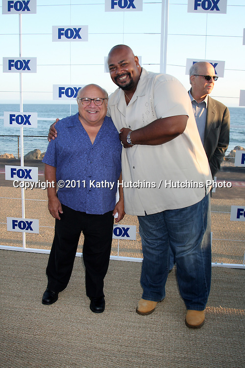 LOS ANGELES - AUG 5:  Danny DeVito, Kevin Michael Richardson arriving at the FOX TCA Summer 2011 Party at Gladstones on August 5, 2011 in Santa Monica, CA