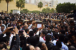 Mourners carry the coffins of the victims of the blast at the Coptic Christian Saint Mark's church in Alexandria the previous day during a funeral procession at the Monastery of Marmina in the city of Borg El-Arab, east of Alexandria on April 10, 2017. Egypt prepared to impose a state of emergency after jihadist bombings killed dozens at two churches in the deadliest attacks in recent memory on the country's Coptic Christian minority. Photo by Amr Sayed