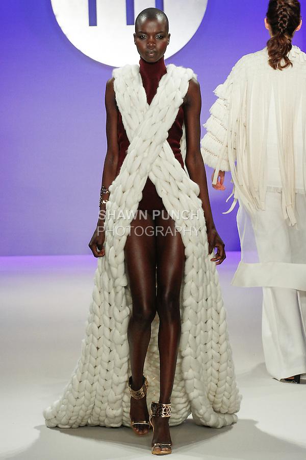 Model walks runway in an outfit by Melissa Mendoza, during the FIT Future of Fashion 2014 Graduates' Collection fashion show, at the Fashion Institute of Technology on May 1, 2014.