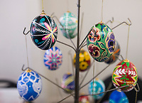 NWA Democrat-Gazette/BEN GOFF @NWABENGOFF<br /> Ukrainian Easter eggs decorated by Kent Kerr and wife Joyce Kerr of Gravette hang on display Friday, March 22, 2019, during a class on the technique lead by the Kerrs at the Gentry Senior Activity Center. The senior activity center holds a craft making class each Friday.