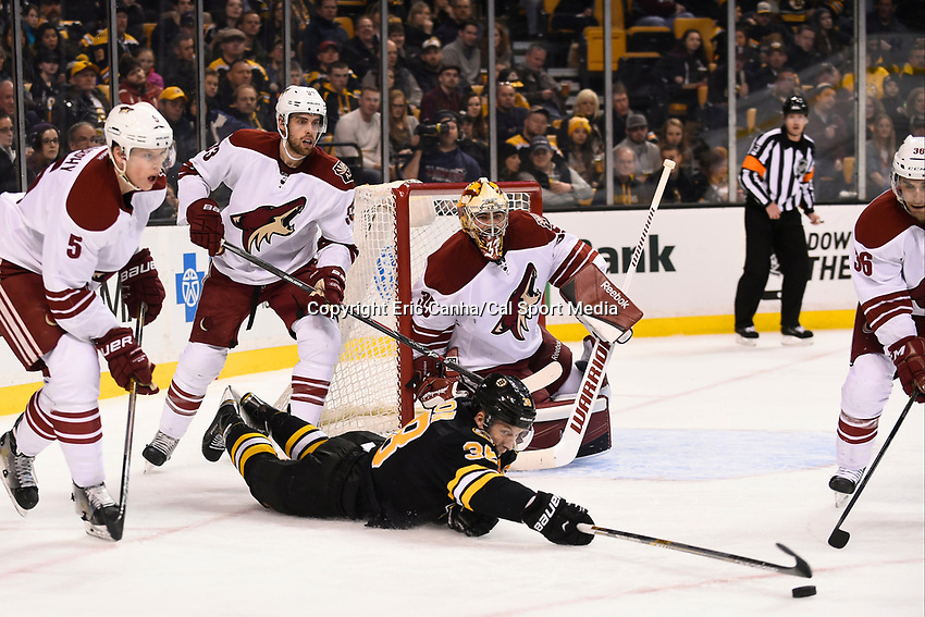 February 28, 2015 - Boston, Massachusetts, U.S. - Boston Bruins left wing Jordan Caron (38) reaches for the puck after losing his footing during the NHL match between the Arizona Coyotes and the Boston Bruins held at TD Garden in Boston Massachusetts. The Bruins defeated the Coyotes 4-1 in regulation time. Eric Canha/CSM