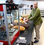 WATERBURY CT. 11 December 2018-121018SV01-Sarah Velez gets bread ready for sale at the Brooklyn Baking Company on Reidville Drive in Waterbury Tuesday.<br /> Steven Valenti Republican-American