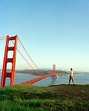USA, California, Marin Headlands, woman hiking, Golden Gate Bridge, San Francisco