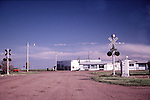 GAS STATION AND RAILROAD CROSSING IN COLORADO TOWN