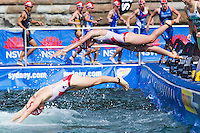 10 APR 2011 - SYDNEY, AUS - Kirsten Sweetland (top) dives in behind Paula Findlay as they start their second swim lap at the women's ITU World Championship Series triathlon in Sydney, Australia  (PHOTO (C) NIGEL FARROW)