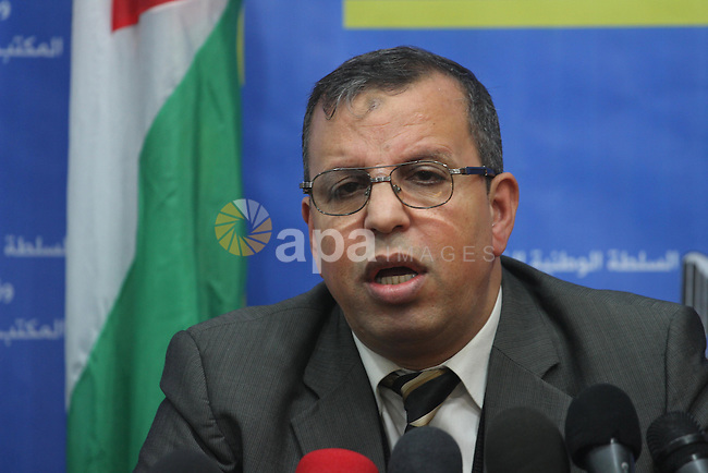 Official of the Palestinian refugees in the Ministry of Foreign Affairs in Gaza, Yousef al-Mudallal speaks during a press conference to discuss the situation in the Yarmouk refugee camp in Syria, in Gaza city on Jan. 12, 2014. Photo by Mohammed Asad