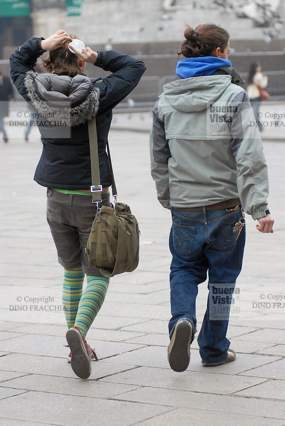 - Milan, young people in Duomo square....- Milano, giovani in piazza del Duomo