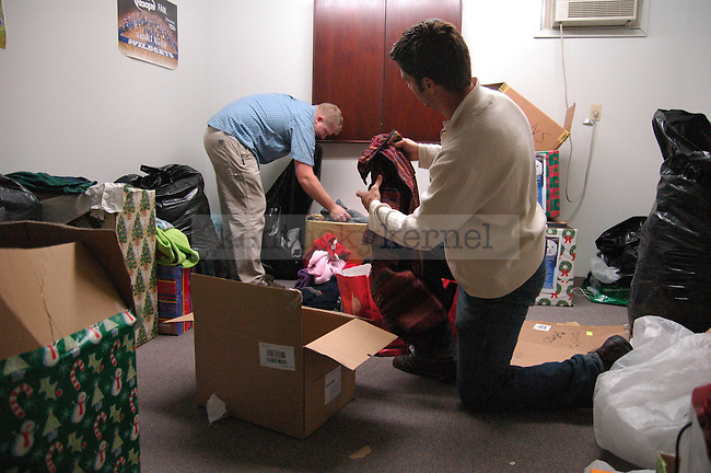 Graduate students Nick Gould (left) and Jacob Sither sort through clothes donated to the Wildcat Warmth project at the Reynolds building on Thursday November 12th 2009. Photo by Jon Reynolds | Staff