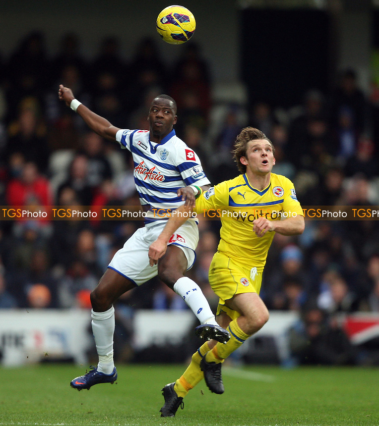 Samba Diakite of QPR and Jay Tabb of Reading - Queens Park Rangers vs Reading, Barclays Premier League at Loftus Road, London - 04/11/12 - MANDATORY CREDIT: Rob Newell/TGSPHOTO - Self billing applies where appropriate - 0845 094 6026 - contact@tgsphoto.co.uk - NO UNPAID USE.