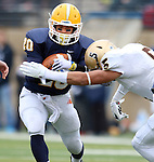 SIOUX FALLS, SD - NOVEMBER 16: Dajon Newell #20 from Augustana is brought down by AJ Page #5 from Southwest Minnesota State in the first quarter of their game Saturday at Augustana. (Photo by Dave Eggen/Inertia)