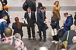 Manhattan, New York, U.S. 4th November 2013. Former New York Governor DAVID PATERSON, (center L) runs into TOM SUOZZI, Democratic candidate for Nassau County Executive, (center R) in front of the escalators during Suozzi's campaign stop at Penn Station, near end of 36 straight hours of barnstorming across Nassau County, leading up to the November 5 general election. Former Nassau County Executive Suozzi and incumbent Republican Mangano are once again facing each other as challengers.