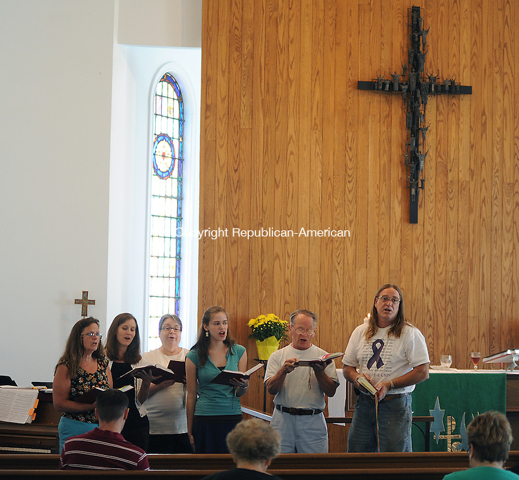 NAUGATUCK, CT-08 JULY 2012--070812JS04- Choir members sing a hymn during the a joint service with Immanuel Evangelical Lutheran Church and Salem Lutheran Church at Immanuel Evangelical Lutheran Church in Naugatuck. The church is celebrating its 111th anniversary  this month. At this time, Immanuel and Salem Lutheran Church are sharing a two-point ministry with Pastor Lena Warren serving as spiritual advisor. .Jim Shannon Republican-American