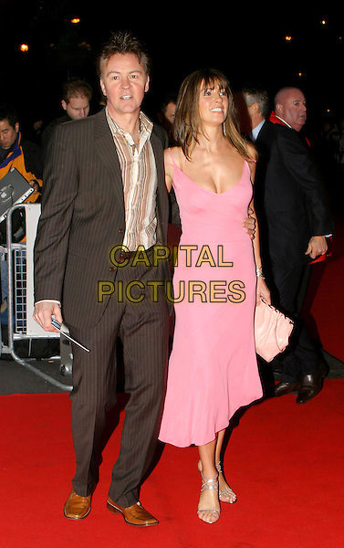 PAUL & STACEY YOUNG.Daily Mirror's Pride Of Britain Awards at the London Hilton, Park Lane.15 March 2004.full length, full-length, Stacy, pink dress.www.capitalpictures.com.sales@capitalpictures.com.© Capital Pictures.