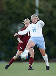 UNC's Elizabeth Guess (30) tries to keep the ball away from Florida State's Katrin Schmidt (14) on Friday, November 25th, 2005 at Fetzer Field in Chapel Hill, North Carolina. The Florida State Seminoles defeated the University of North Carolina Tarheels 5-4 on penalty kicks after the teams tied 1-1 after overtime during their NCAA Women's Soccer Tournament quarterfinal game.