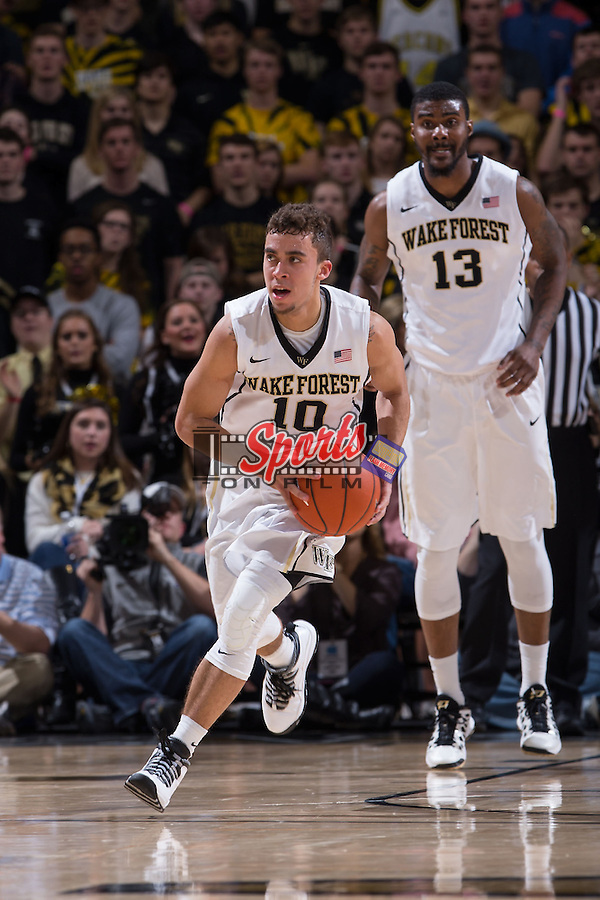 Mitchell Wilbekin (10) of the Wake Forest Demon Deacons brings the ball up the court during second half action against the North Carolina Tar Heels at the LJVM Coliseum on January 21, 2015 in Winston-Salem, North Carolina.  The Tar Heels defeated the Demon Deacons 87-71.  (Brian Westerholt/Sports On Film)