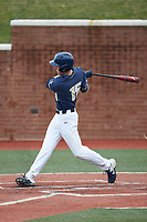 Mitch Farris (15) of the Wingate Bulldogs follows through on his swing against the Concord Mountain Lions at Ron Christopher Stadium on February 1, 2020 in Wingate, North Carolina. The Bulldogs defeated the Mountain Lions 8-0 in game one of a doubleheader. (Brian Westerholt/Four Seam Images)
