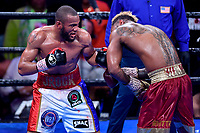 """Fairfax, VA - May 11, 2019: Julian J-Rock"""" Williams lands a left hook against Jarrett """"Swift"""" Hurd during Jr. Middleweight title fight at Eagle Bank Arena in Fairfax, VA. Julian Williams defeated Hurd to take home the IBF, WBA and IBO Championship belts by unanimous decision. (Photo by Phil Peters/Media Images International)"""