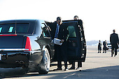 """Arlington, VA - January 16, 2009 -- United States President-Elect Barack Obama arrives at Reagan National Airport (DCA) to travel to Bedford Heights, Ohio to discuss his """"American  Recovery and Reinvestment Plan"""".  He is seen here dropping his Blackberry on the ground while exiting his vehicle. .Credit: Gary Fabiano - Pool via CNP"""