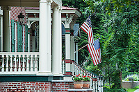 American flag and house porches, USA