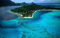Aerial of the green and blue waters of the islands of Bora Bora, Tahiti, French Polynesia