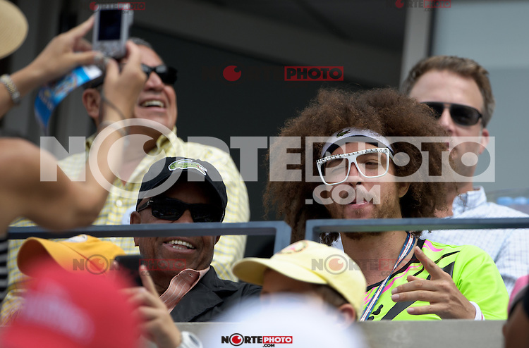 September 2, 2012: Stefan 'Redfoo' Gordy (R) of LMFAO with his father Berry Gordy, Jr. watch the action during Day 7 of the 2012 U.S. Open Tennis Championships at the USTA Billie Jean King National Tennis Center in Flushing, Queens, New York, USA. Credit: mpi105/MediaPunch Inc. /NortePhoto.com<br /> <br /> **CREDITO*OBLIGATORIO**<br /> *No*Venta*A*Terceros*<br /> *No*Sale*So*third*<br /> *** No Se Permite Hacer Archivo**