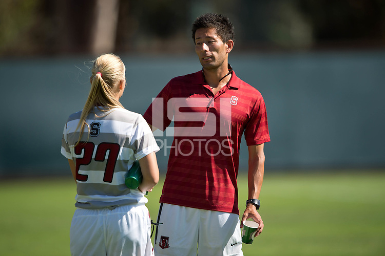 STANFORD, CA - SEPTEMBER 7, 2014:  Assistant Coach Hideki Nakada and Taylor Uhl after Stanford's game against Notre Dame. The Cardinal and Irish played to a 0-0 draw after two 10-minute overtime periods.