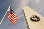 Veterans Memorial Obelisk in the middle of the traffic circle at the county courthouse; US Flags