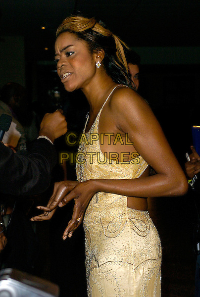 ANTONIA OKONMA.At the Screen Nation Film & TV Awards, .Hilton Park Lane Hotel, London, England, .October 10th 2006..half length gold silver beaded dress hands.Ref: CAN.www.capitalpictures.com.sales@capitalpictures.com.©Can Nguyen/Capital Pictures