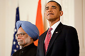 Washington, DC - November 24, 2009 -- United States President Barack Obama, right, and Manmohan Singh, India's prime minister, listen to the national anthem during a ceremony in the East Room of the White House in Washington, D.C., U.S., on Tuesday, November 24, 2009. Singh was welcomed to the White House this morning by Obama for a state visit where the two leaders will have discussions on curbing nuclear weapons, climate change and trade. .Credit: Andrew Harrer - Pool via CNP