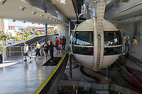 Las Vegas, Nevada.  Passengers Exiting a Gondola on Left as new Passengers Arrive on Right for the High Roller, World's Tallest Observation Wheel as of 2015.