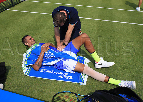 June 19th 2017, Queens Club, West Kensington, London; Aegon Tennis Championships, Day 1; Nick Kyrgios of Australia receives medical treatment on court side after an injury attempting to play a forehand versus Donald Young of USA