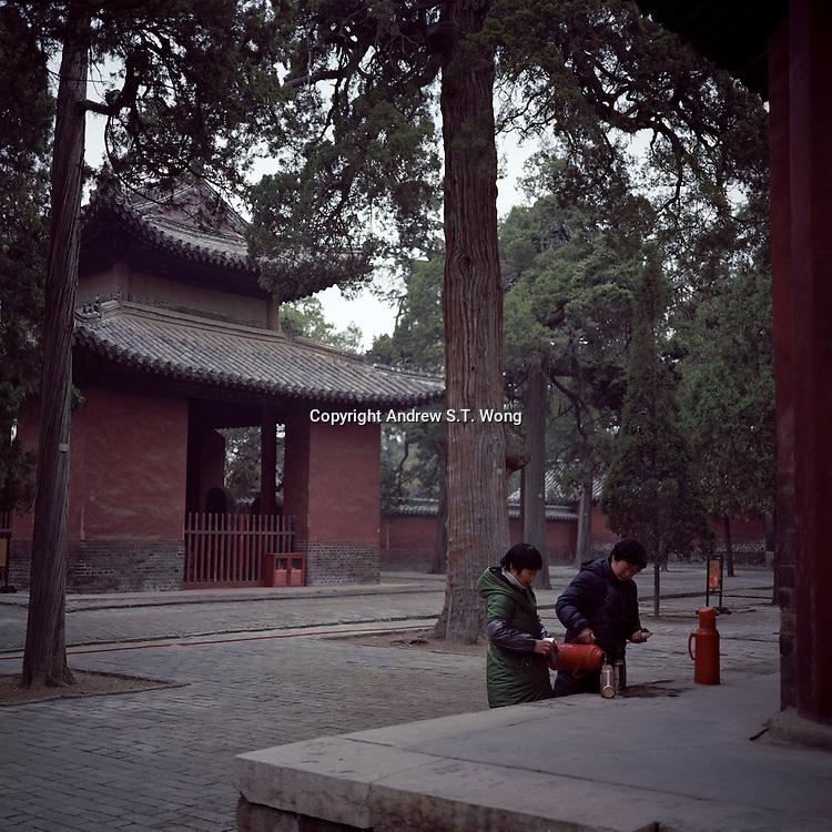 Chinese woman workers make tea at the Confucius Temple in Qufu City, Shandong province, 2012. (Mamiya 6, 75mm f3.5, Kodak Ektar 100 film)