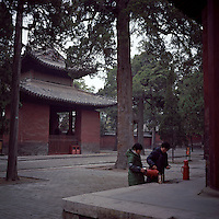 Chinese woman workers make tea at the Confucius Temple in Qufu City, Shandong province, 2012. (Mamiya 6, 75mm f3.5, Kodak Ektar 100 film)