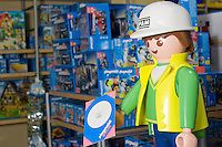Quebec city, August 1, 2008 - A giant Playmobil character is on display at the Benjo toy store on St-Joseph street in Quebec city. Benjo is a 28,000-square-foot game and toy store filled with dolls, teddy bears, crafts, candy, model trains and cars, and more.