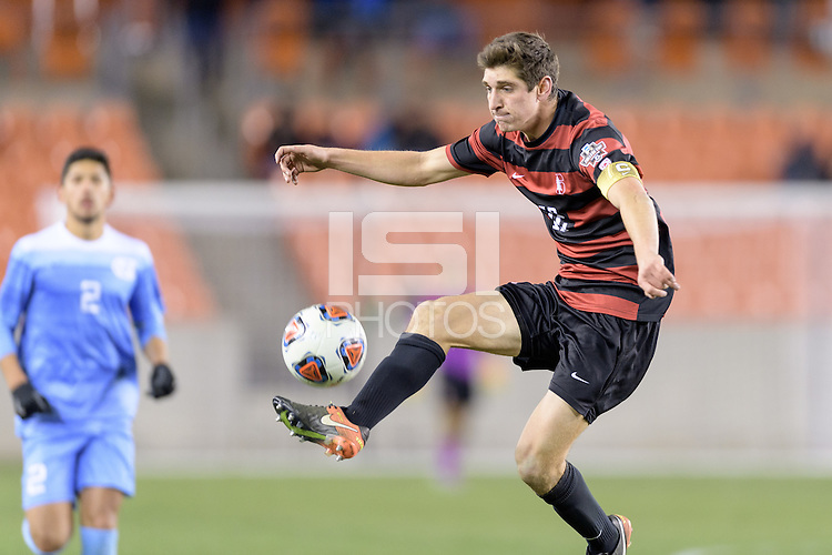 Houston, TX - Friday December 9 2016: Drew Skundrich (12) of the Stanford Cardinal gains control of a loose ball against the North Carolina Tar Heels at the NCAA Men's Soccer Semifinals at BBVA Compass Stadium in Houston Texas.