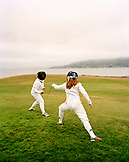 USA, California, mother and daughter fencing in park, Tiburon