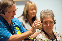NWA Democrat-Gazette/CHARLIE KAIJO Tom O'Neal of Bella Vista puts a sea shell up to wife Sue O'Neal's ear at Creative Connections event at the Crystal Bridges museum in Bentonville, AR on Monday, September 11, 2017. They have been married 52 years. Creative Connections is a program for individuals in the early stages of Alzheimer's or dementia and their care partners. Museum Educators facilitate interactive discussions of artworks in the galleries, followed by hands-on art activities in the studio.