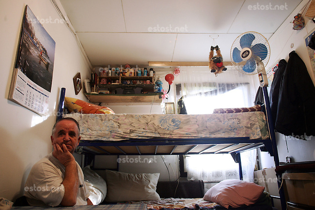 "SERBIA, Belgrade, Jan. 18, 2007..Nikola Djordjevic  (62) refugee from Kosovo, Djakovica, sits in his room in a refugee camp ""Krnjaca"" near Belgrade..© Djordje Jovanovic /EST&OST"