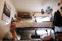 """SERBIA, Belgrade, Jan. 18, 2007..Nikola Djordjevic  (62) refugee from Kosovo, Djakovica, sits in his room in a refugee camp """"Krnjaca"""" near Belgrade..© Djordje Jovanovic /EST&OST"""